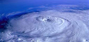 Hurricane forming above earth from space