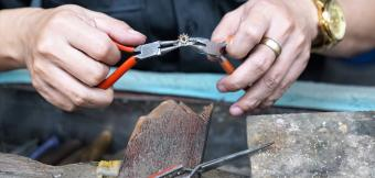 Person creating ring with pliers